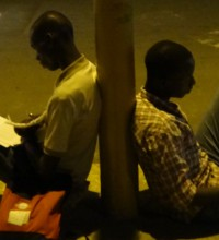 Students using street lights in Dakar to study, September 2012.