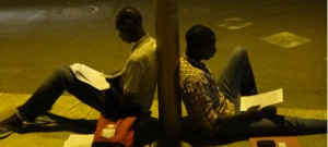 Students using street lights in Dakar to study, September 2012.